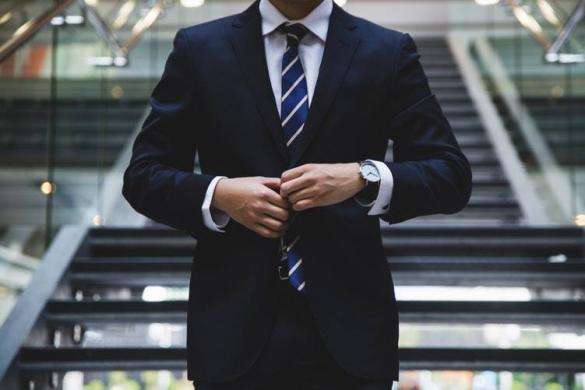 A successful man in a suit that used self hypnosis audio to generate his success