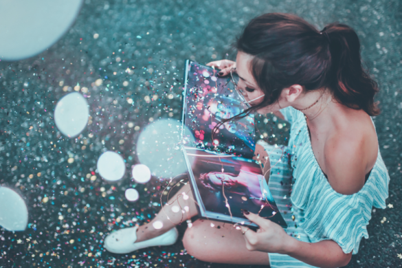 A woman reading a book about how to change your self image with visualization
