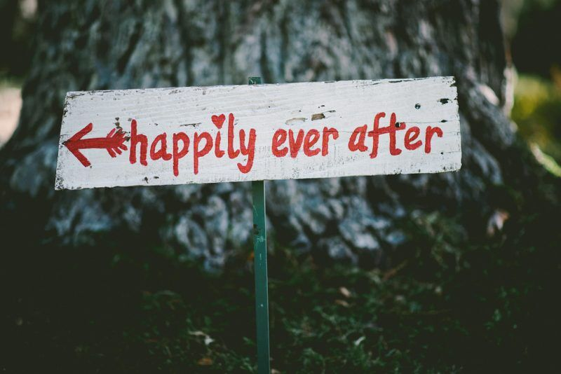 A sign that says 'happily ever after' written in red