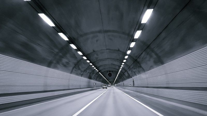 Driving in a long gray tunnel.