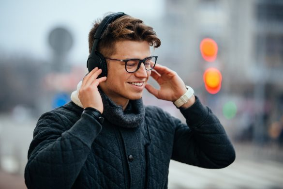 A man on the street listening to subliminal messages of Subliminal360